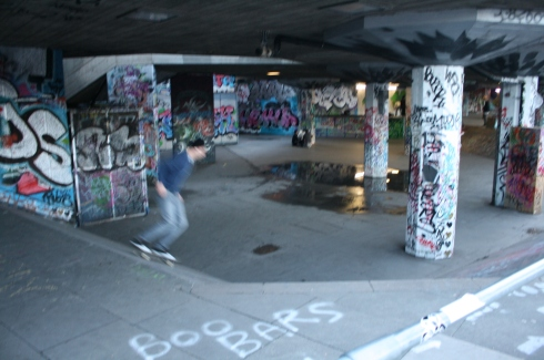 Skateboarding under Southbank